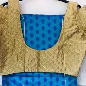 Blue soft silk dual toned saree with gold blouse.